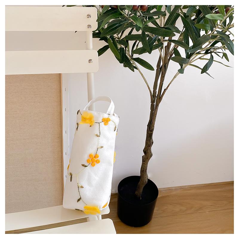 黄色の立体花の水コップの包み